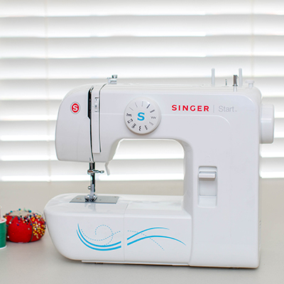 SINGER<sup>®</sup> Start™ Sewing Machine - Great for a hobbyist or beginner, this sewing machine features 6 basic stitches pre-set and accessed by the simple turn of a dial. Offers easy threading, a heavy-duty metal frame for skip-free sewing and automatic 4-step buttonhole. Includes stitch guide and free accessories including 3 snap-on presser feet.